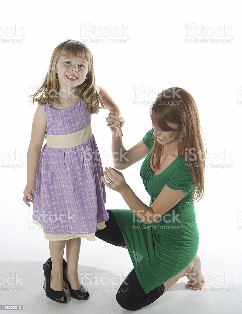 Little Girl Wearing Grown Up Shoes royalty-free stock photo