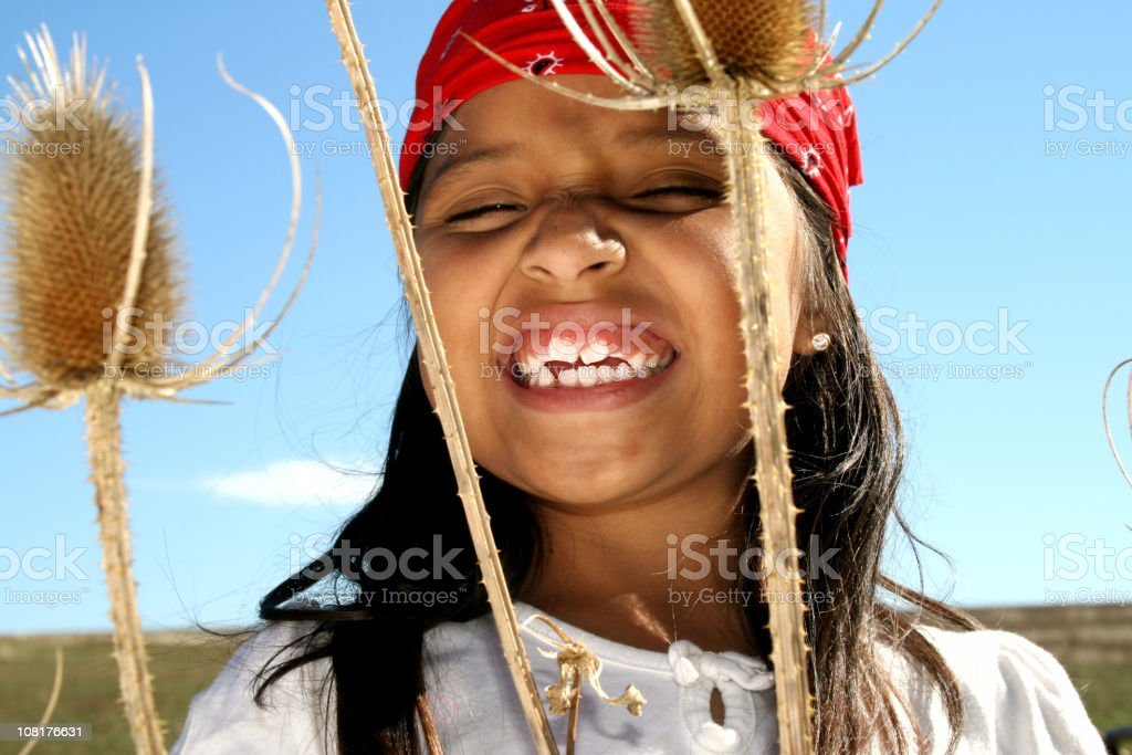 Little Girl Wearing Hippie Clothing stock photo