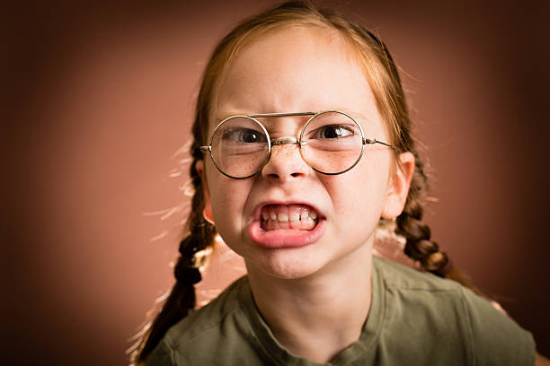 Little Girl Wearing Nerdy Glasses Making a Mean Face