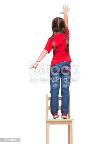 istock little girl wearing red t-shirt and reaching out something 185038019
