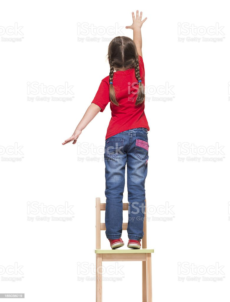 little girl wearing red t-shirt and reaching out something stock photo