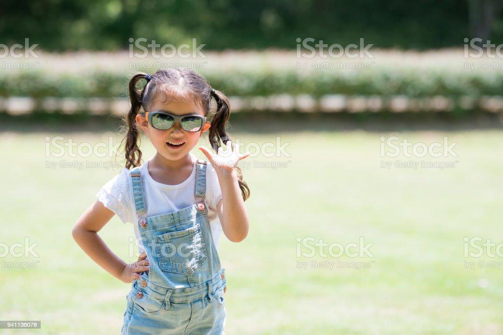 Little girl wearing sunglasses stock photo