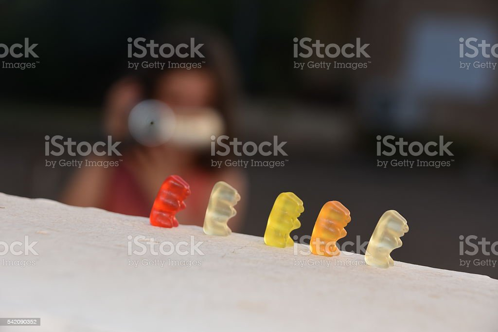 little girl webcam gummy bears stock photo
