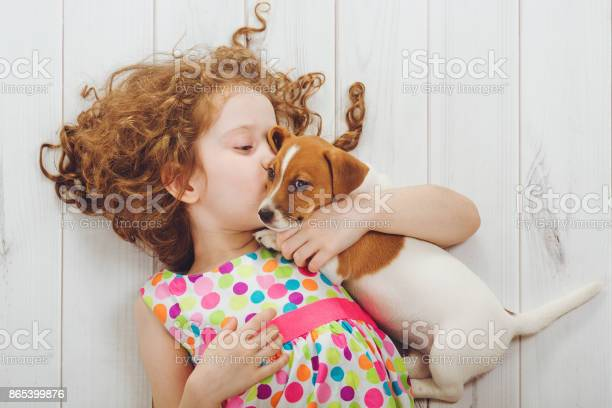 Little girl whispers with her puppy jack russell picture id865399876?b=1&k=6&m=865399876&s=612x612&h= wubgjlxpjkjkqy1cuj8df2xgza beinbruk8h1bnae=