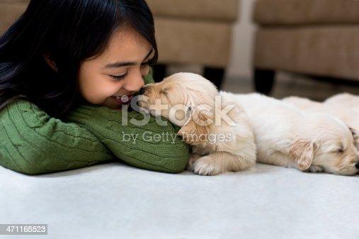 Little girl whit a puppy