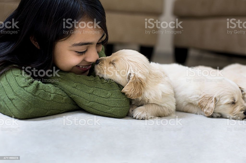 Little girl whit a puppy stock photo