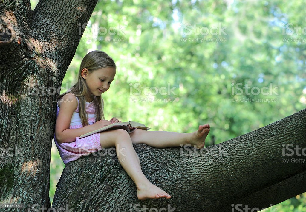 Little girl with a book royalty-free stock photo