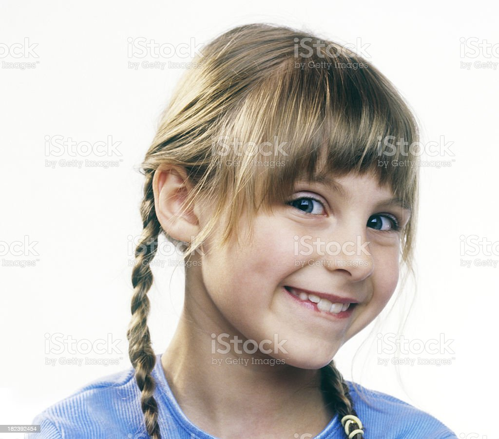 Little Girl with a Funny Grin stock photo