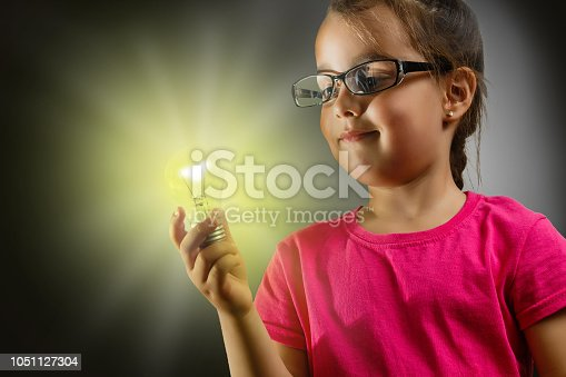 1019302738istockphoto Little girl with a lit lamp in hand 1051127304