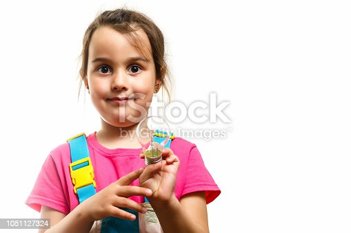 1019302738istockphoto Little girl with a lit lamp in hand 1051127324