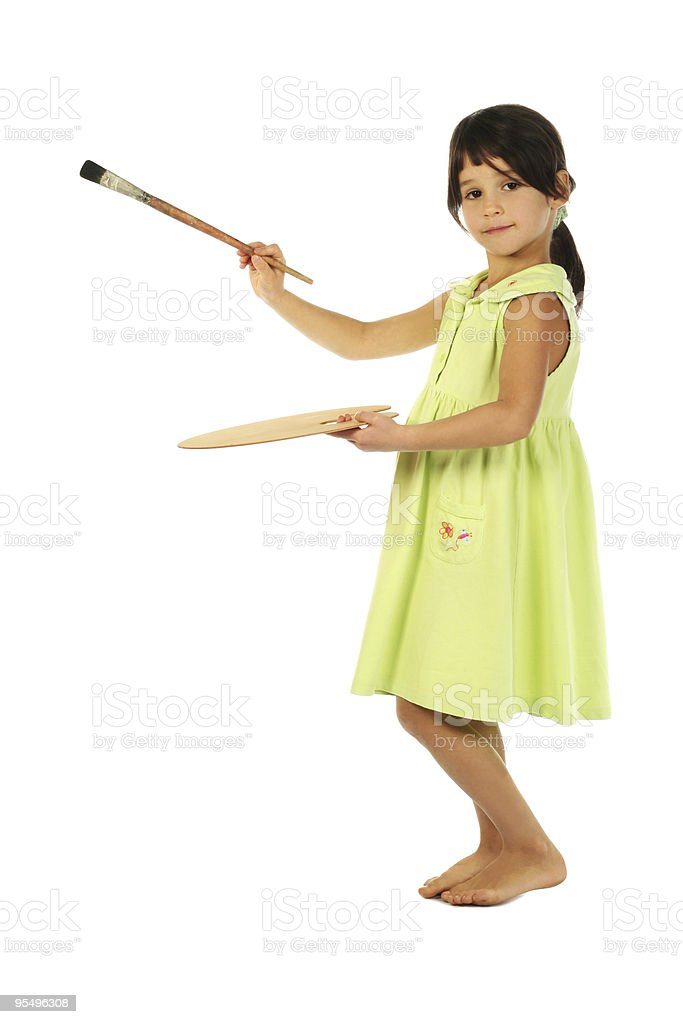 Little girl with a paintbrush royalty-free stock photo