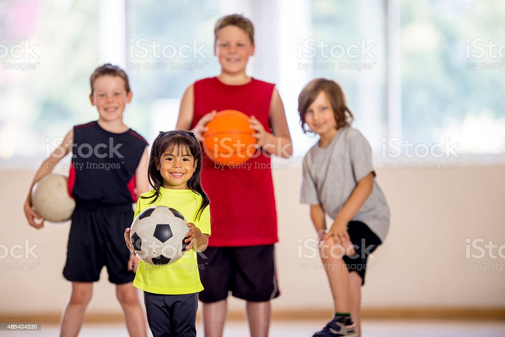 Little Girl with a Soccer Ball stock photo