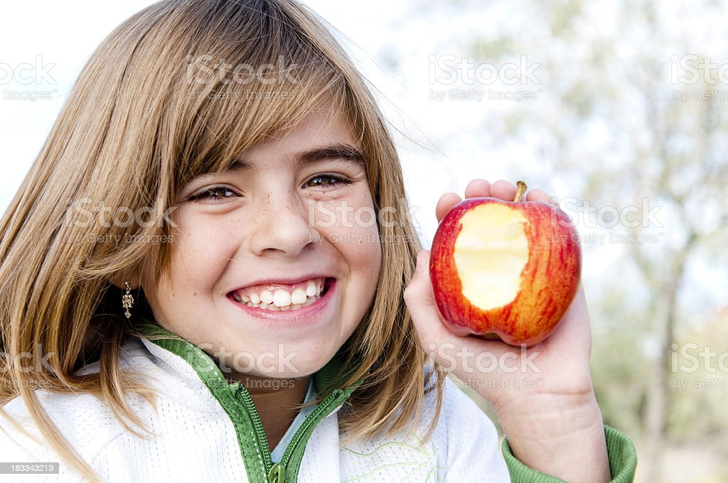 Little Girl with an Apple stock photo