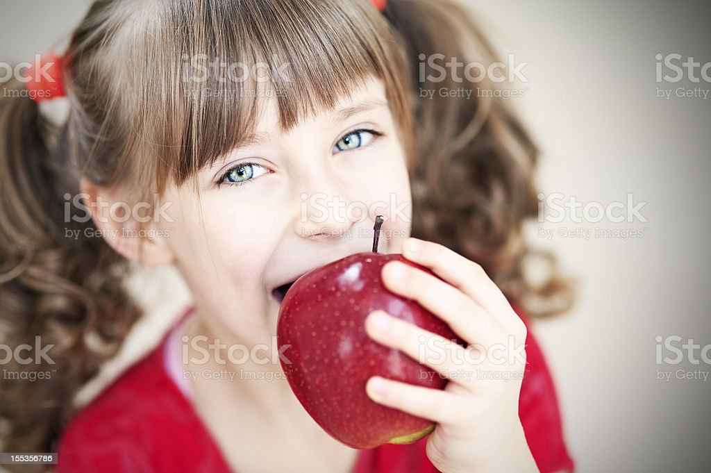 Little girl with apple royalty-free stock photo