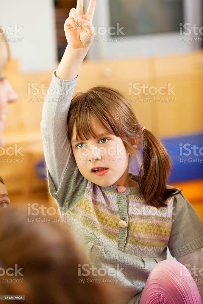 Little Girl With Arm Raised at school royalty-free stock photo