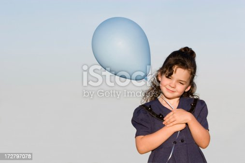 istock Little Girl with Balloon 172797078