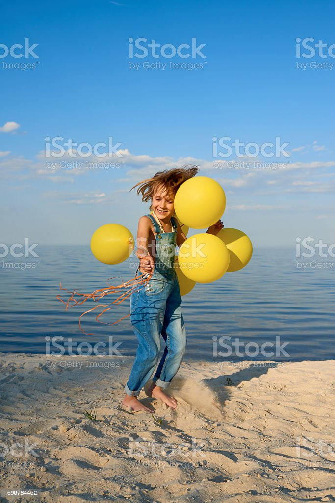 Little Girl with Balloons at Beach stock photo