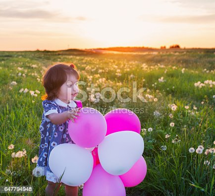 istock little girl with balloons outdoor 647794948