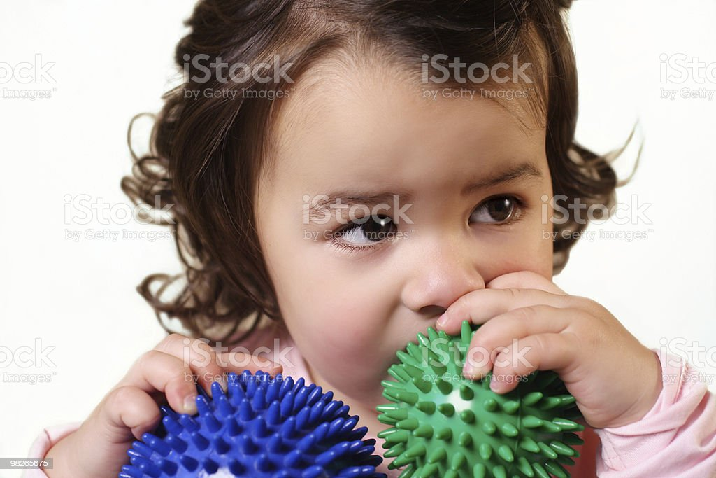 Little girl with balls royalty-free stock photo