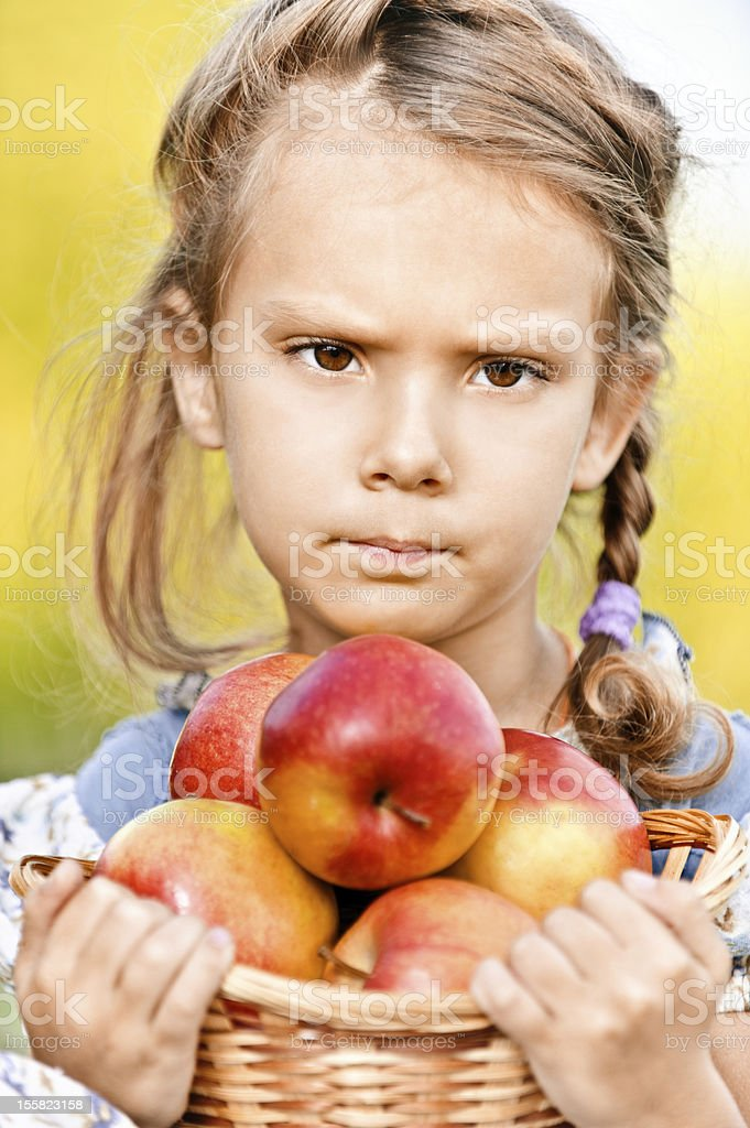 Little girl with basket of apples royalty-free stock photo