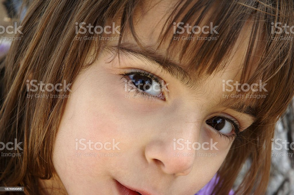 Little Girl with Beautiful Eyes Looks at  You stock photo