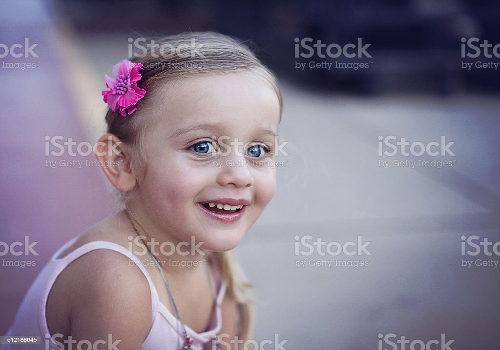 Little Girl with Big Blue Eyes and Look of Surprise stock photo
