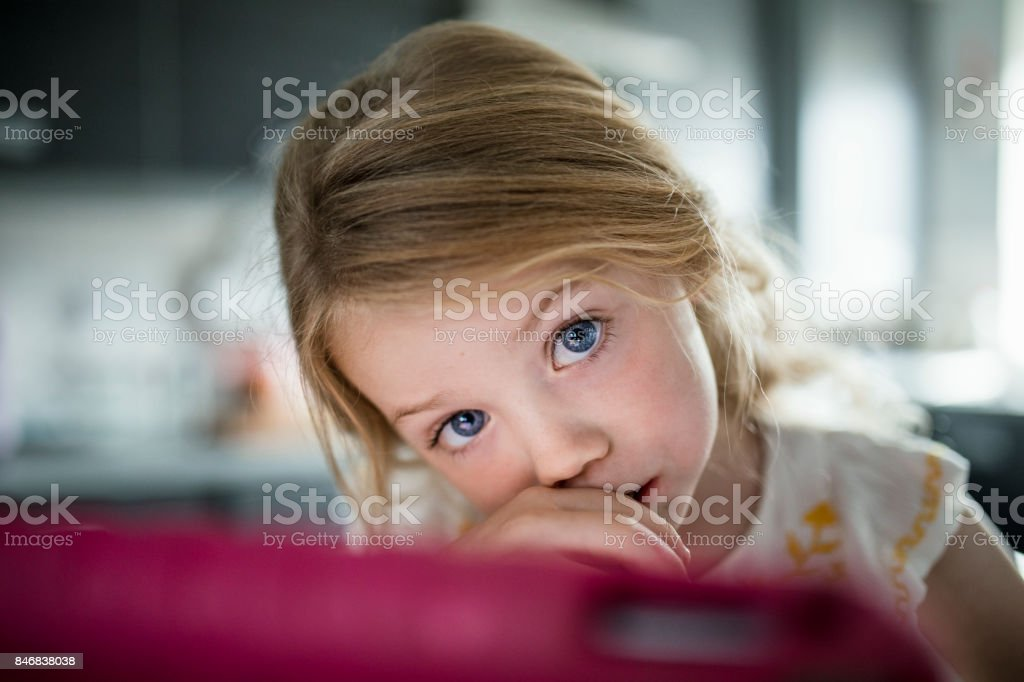 Little Girl with Big Blue Eyes stock photo