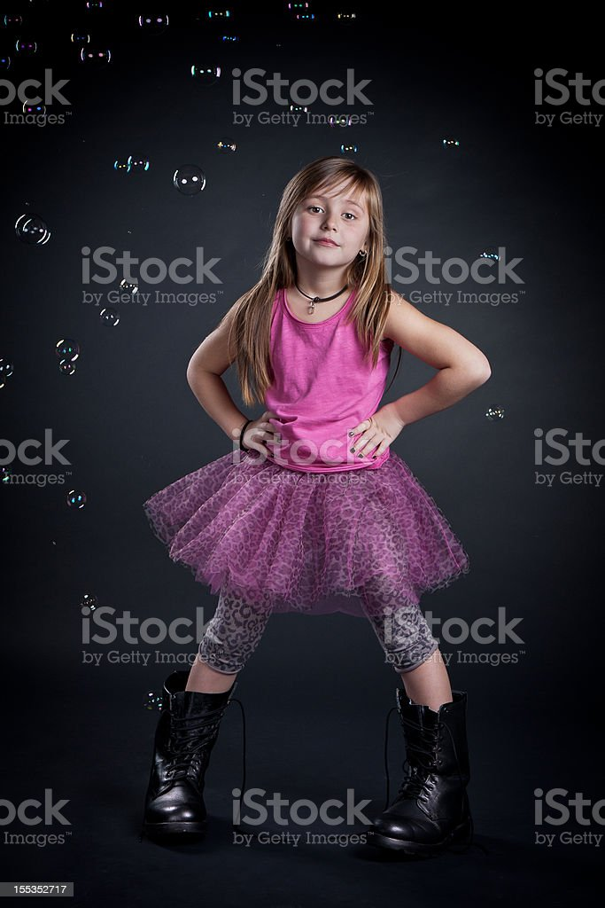Little girl with big boots. royalty-free stock photo