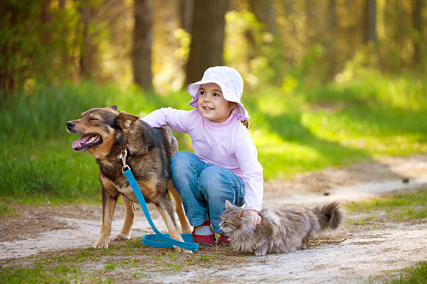 Little girl with big dog and cat in the forest picture id498207545?b=1&k=6&m=498207545&s=612x612&w=0&h=5zdn3ppfmxsxoyxzce5ghs7yunw le6vcnsgr71k3y8=