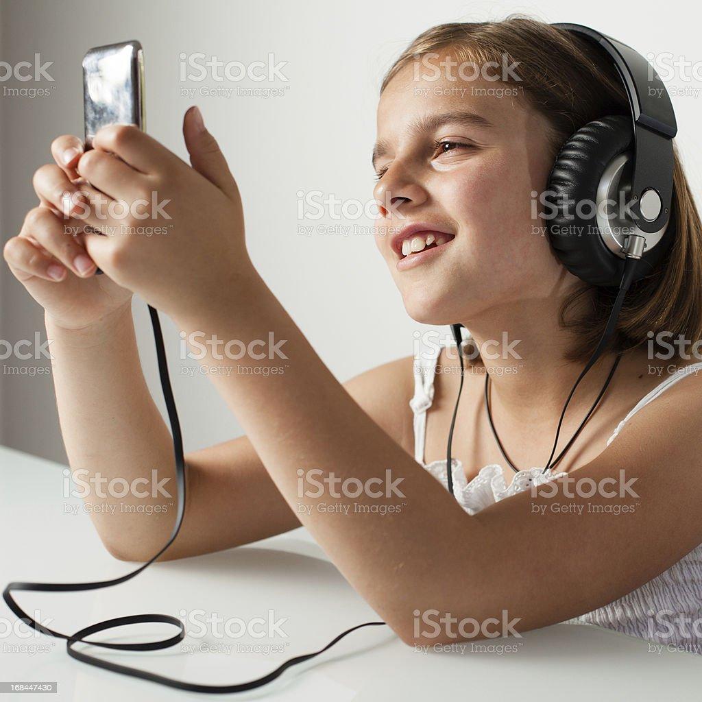 Little Girl with Big Headphones Smiling stock photo