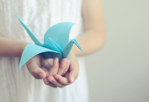 Little girl with blue bird