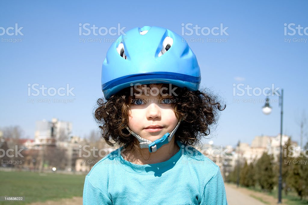 Little girl with blue helmet stock photo