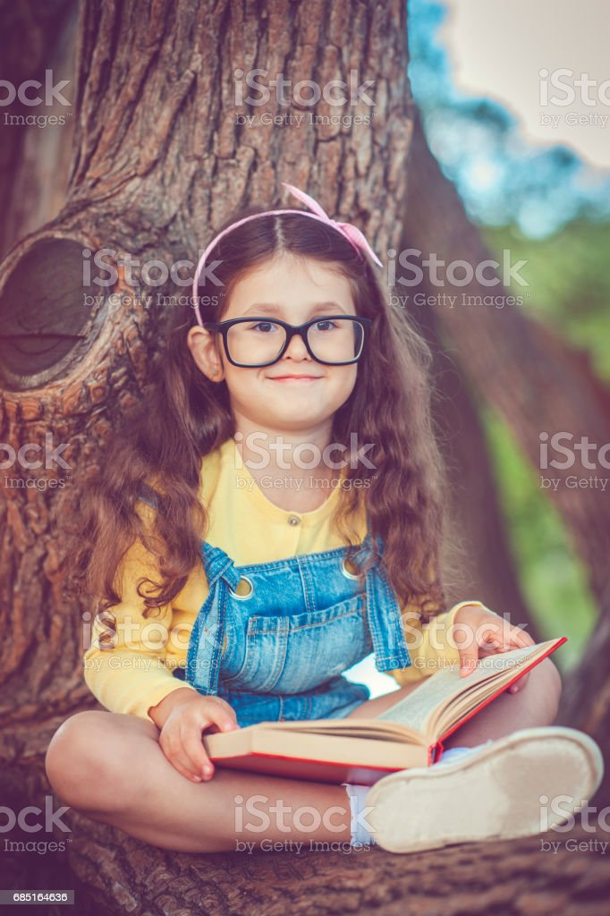Little girl with book foto de stock royalty-free