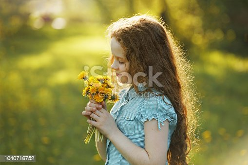 Little girl with bouquet of yellow dandelions. Healthy, medical concept.