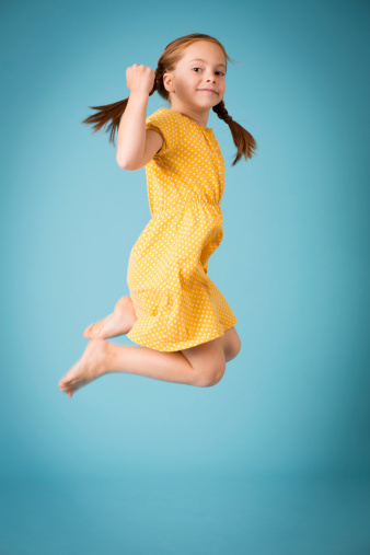 istock Little Girl With Braided Red Hair Jumping Up in Air 187231861