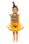 istock Little girl with candy bucket on Halloween 513254829