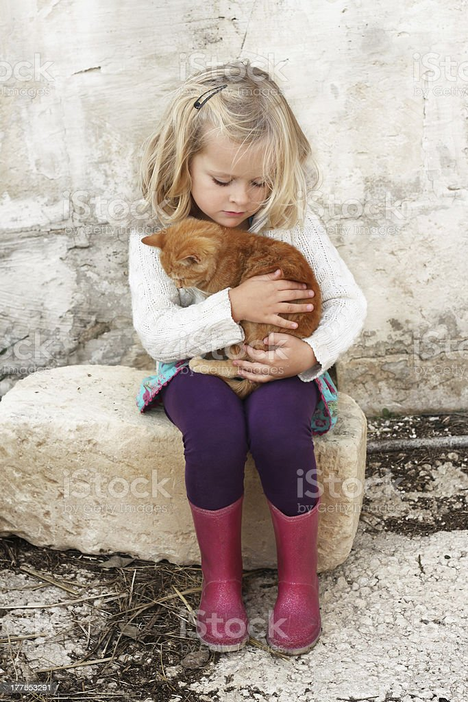 Little girl with cat royalty-free stock photo
