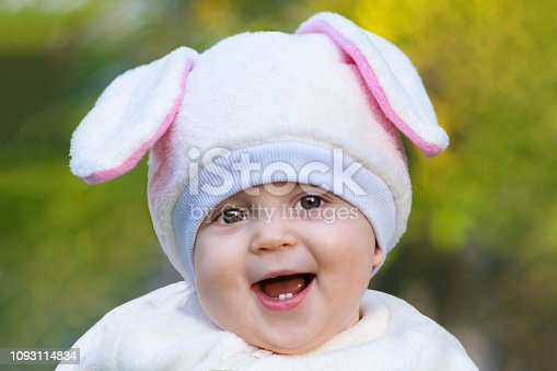 155096501 istock photo Little girl with chubby cheeks in bunny costume laughing 1093114834