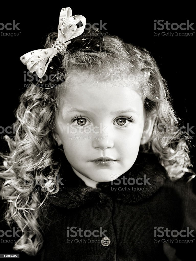 Little girl with curls and a bow royalty-free stock photo