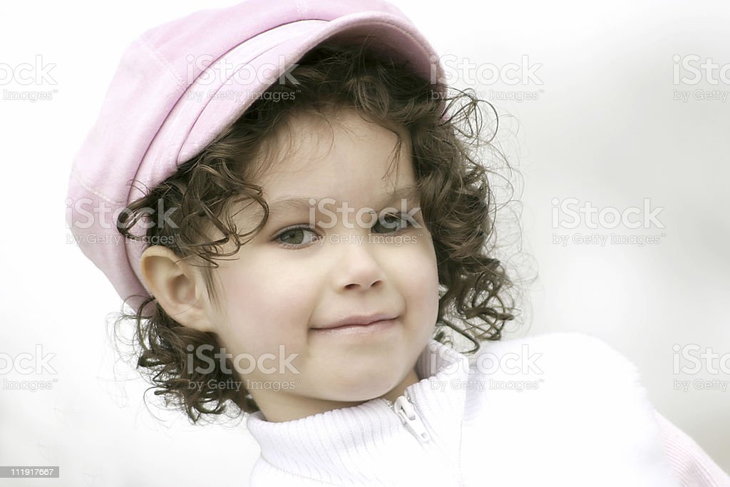 Little Girl With Curly Hair And Pink Hat royalty-free stock photo
