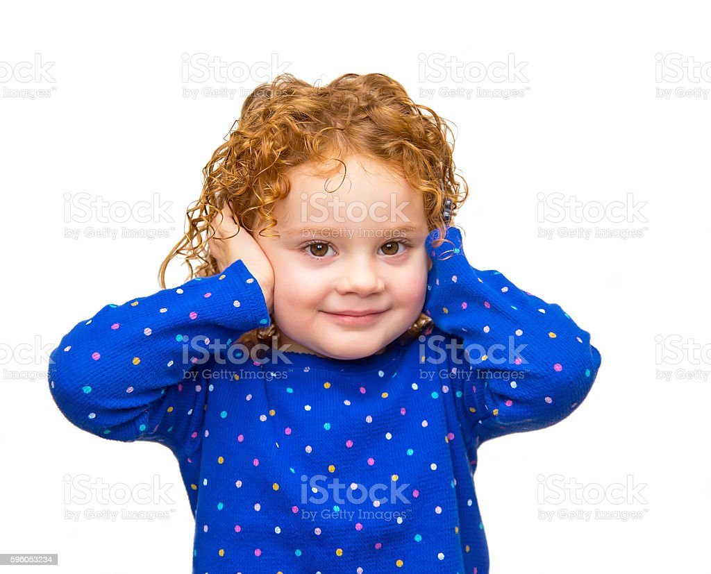 Little Girl With Curly Red Hair Covering Ears royalty-free stock photo
