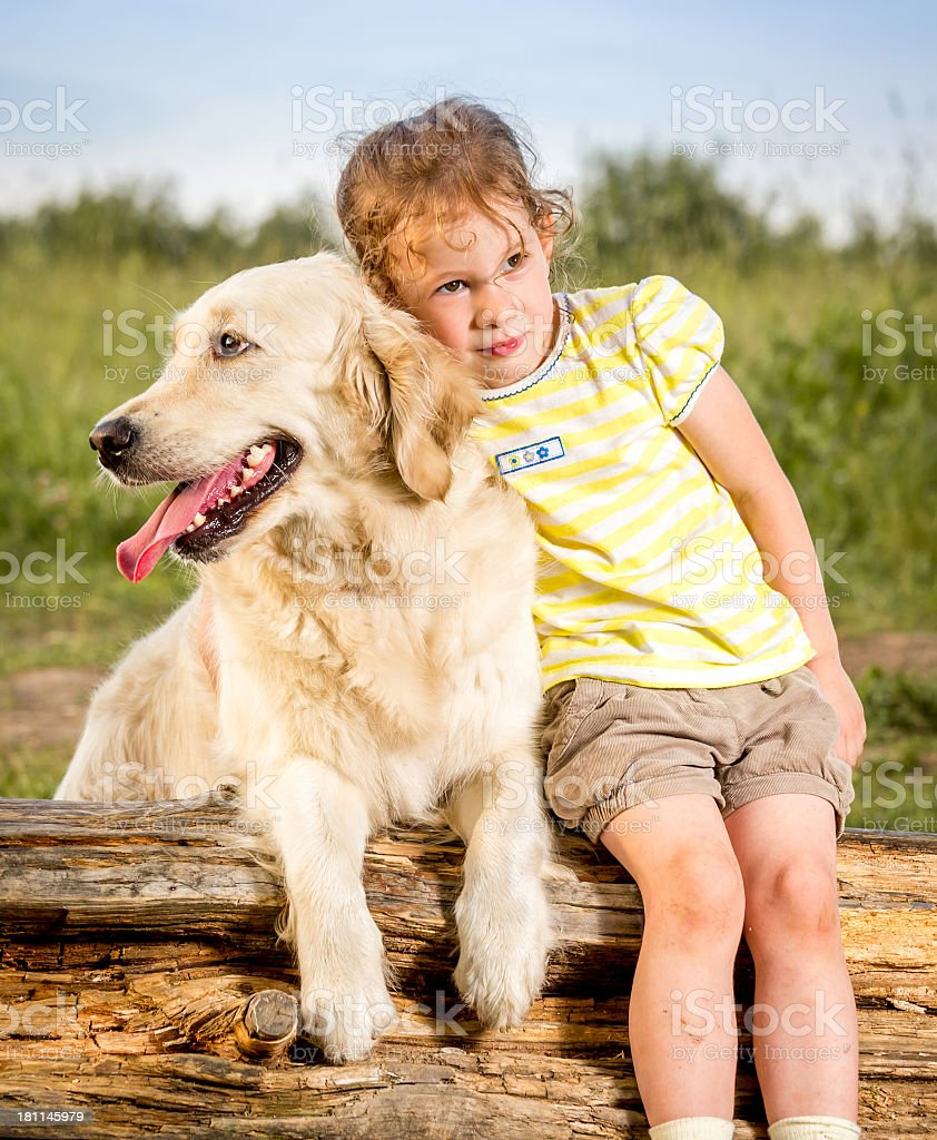 Little girl with dog outdoors royalty-free stock photo