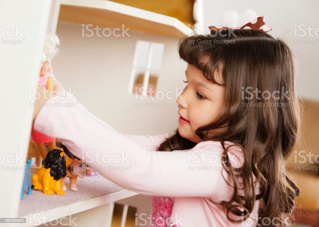 Little Girl with Dollhouse royalty-free stock photo