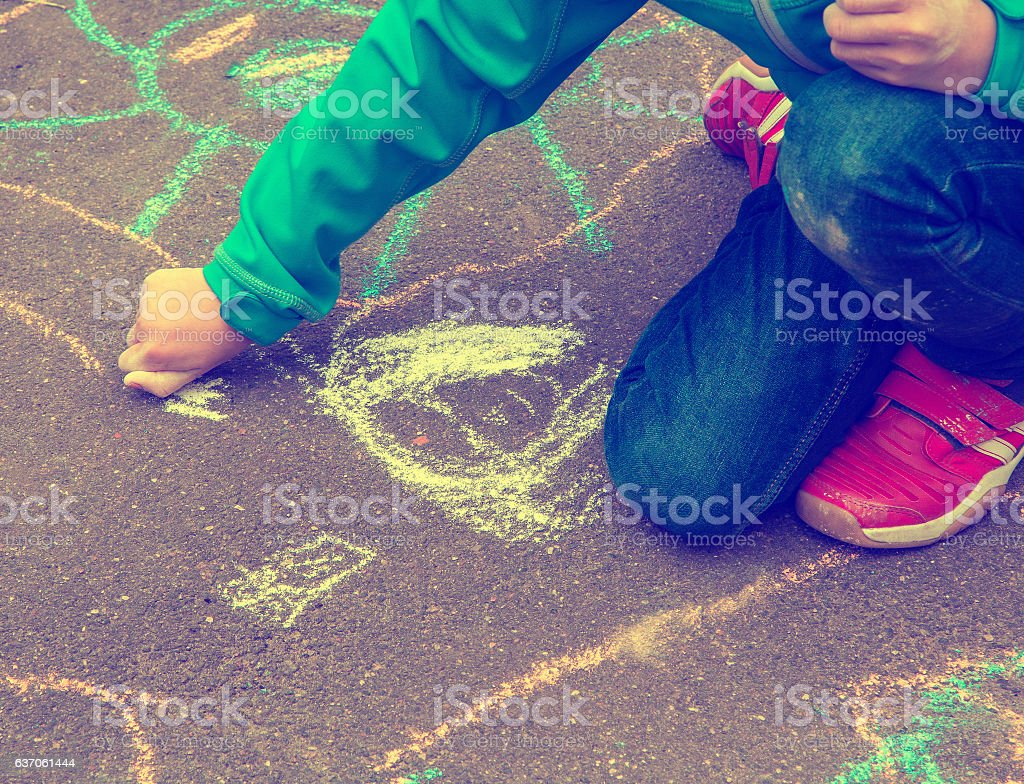 Little girl with drawings on the street stock photo
