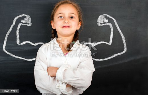 istock Little girl with drawn powerful hands 654102882