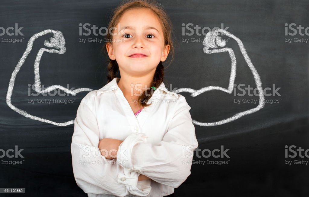 Little girl with drawn powerful hands stock photo