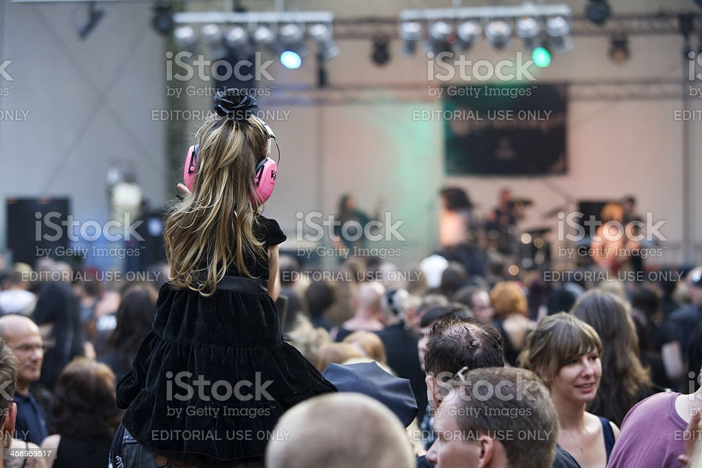 little girl with ear protection on concert stock photo