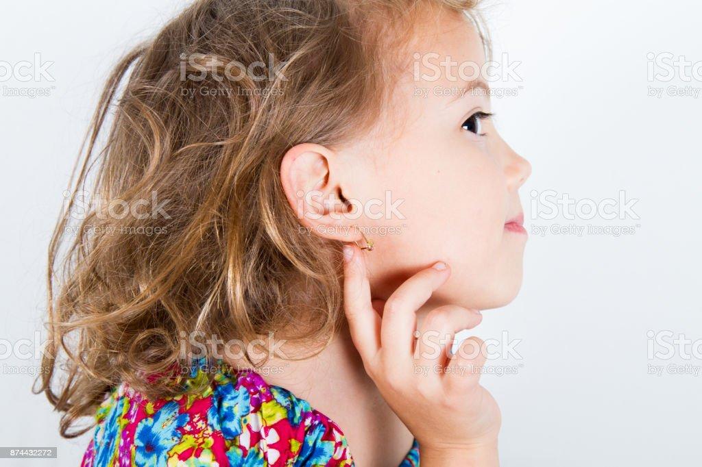 little girl with earring stock photo