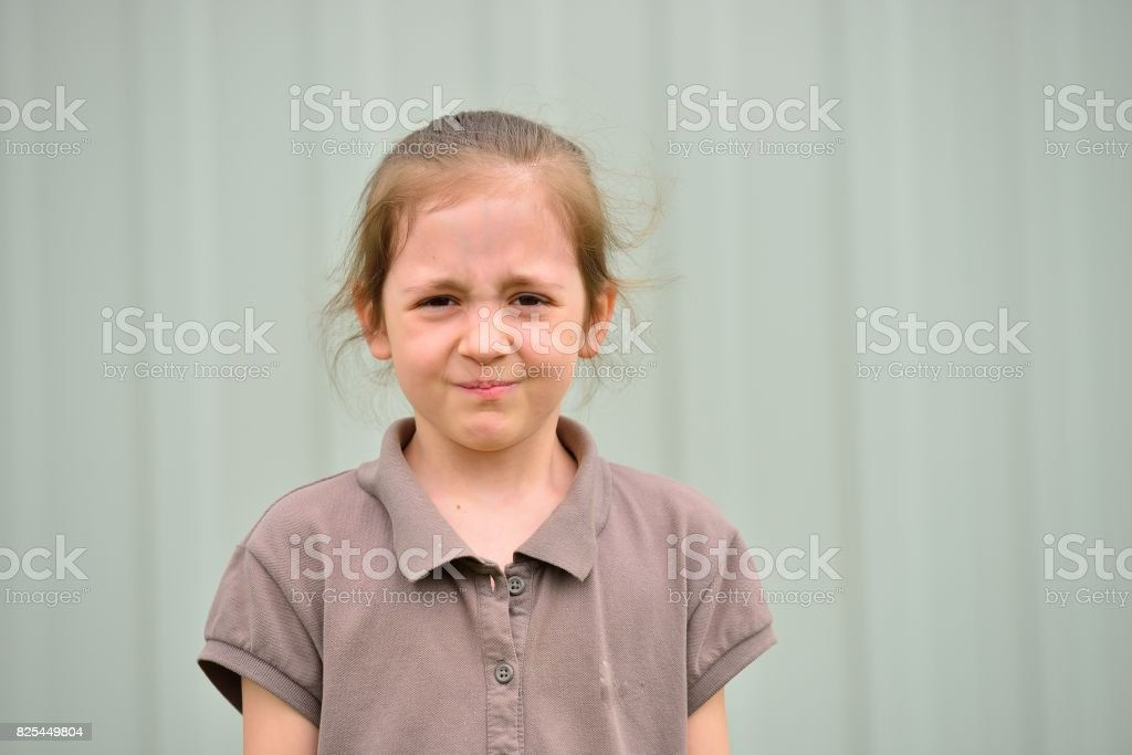 Little girl with emotions on face стоковое фото