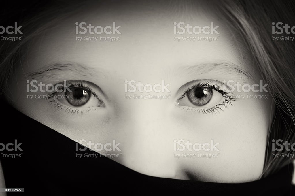 Little Girl With Face Covered Showing Only Eyes royalty-free stock photo
